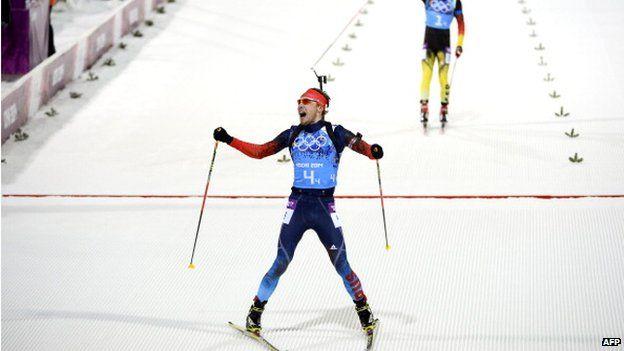 File photo: Russia's Anton Shipulin (bottom) crosses the finish line ahead of Germany's Simon Schempp in the Men's Biathlon 4x7.5 km Relay at the Laura Cross-Country Ski and Biathlon Center during the Sochi Winter Olympics on in Rosa Khutor, near Sochi, 22 February 2014