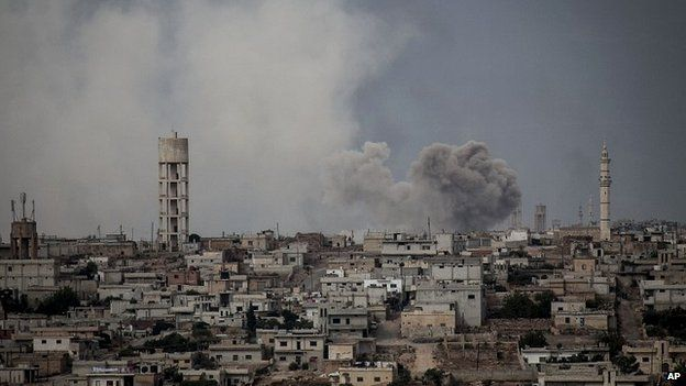 Smoke rises after a bomb was dropped by government forces from a helicopter above a village in Idlib province - 19 September 2013