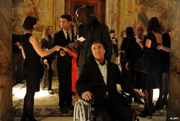 Omar Sy and Francois Cluzet in a scene from the film Les Intouchables, 2011