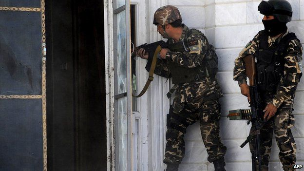 Afghan military at the scene of the attack on the Indian consulate in Herat on 23 May 2014