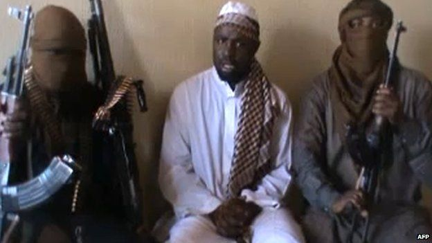A screen grab taken from a video released on You Tube in April 2012, apparently showing Boko Haram leader Abubakar Shekau (centre) sitting flanked by militants