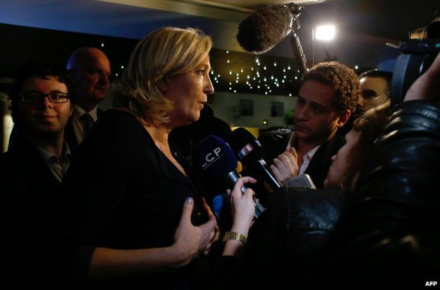 Marine Le Pen answers questions from journalists during a party at the Elysee Lounge bar, in Paris, 25 May