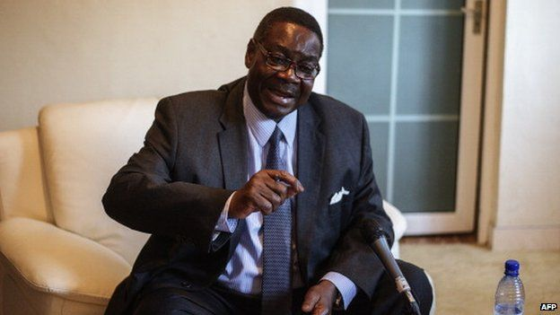 Malawian presidential candidate Peter Mutharika, brother of the late president Bingu wa Mutharika, gestures during a press conference at his residence on 22 May 2014, Blantyre, Malawi
