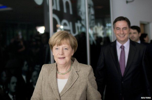 German Chancellor Angela Merkel arrives for a news conference in Berlin, 26 May