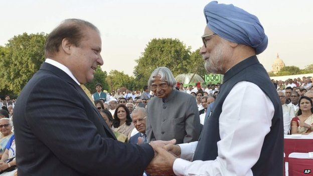 """India""""s outgoing Prime Minister Manmohan Singh, right, greets Pakistani Prime Minister Nawaz Sharif, left, as former Indian president A P J Abdul Kalam, center, watches during the inauguration of new prime minister Narendra Modi in New Delhi, India, Monday, May 26, 2014"""