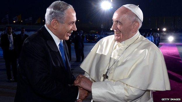 Pope Francis shakes hands with Israeli Prime Minister Benjamin Netanyahu as he departs at Ben Gurion International Airport - 26 May 26, 2014