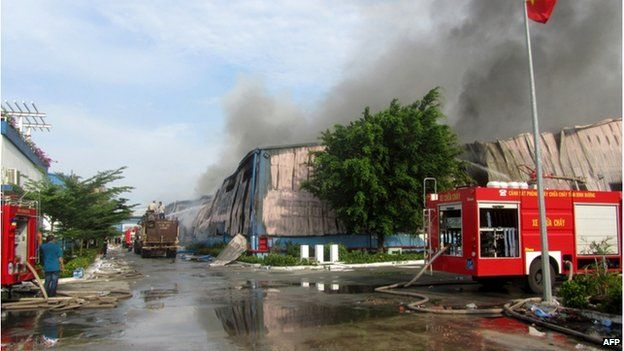 This photo taken on 14 May shows smoke billowing from a Taiwanese furniture factory in Binh Duong as anti-China protesters set more than a dozen factories on fire in Vietnam, according to state media.
