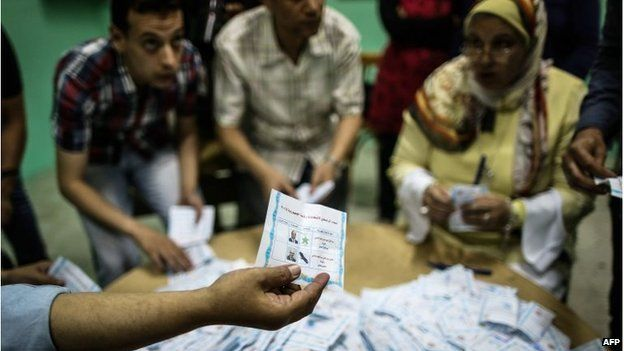 Polling station officials count ballots in the Egyptian capital Cairo on May 28