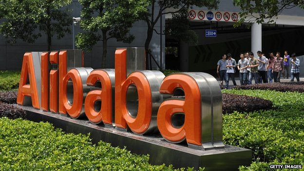 Workers walk out from the Alibaba head office building in Hangzhou, eastern China