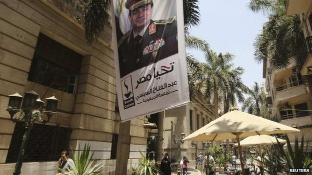 A poster of Abdel Fattah al-Sisi hangs outside the stock exchange in Cairo on 29 May 29, after his overwhelming percent victory