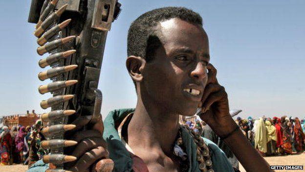 A Somali militant talks on a mobile phone