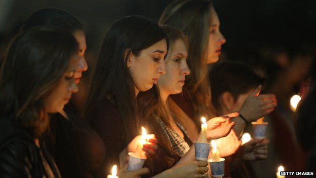 Students at a candlelight vigil for the victims of a killing rampage on May 26, 2014 in Los Angeles, California