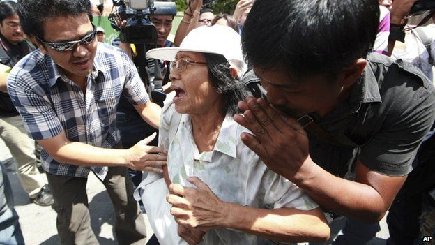 A protester is arrested by plainclothes Thai police officers on 1 June 2014