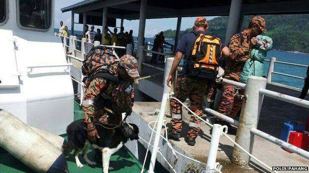 Rescuers in Malaysia