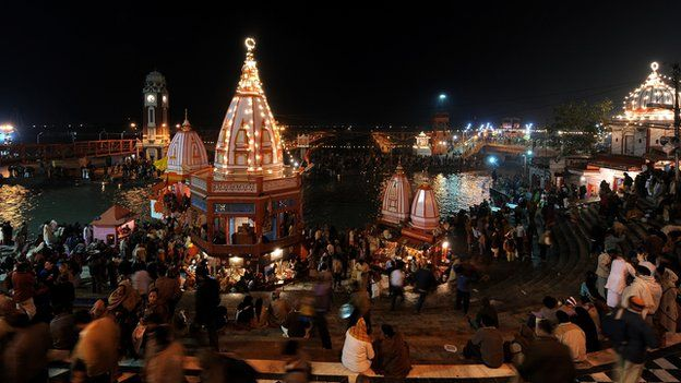 Indian Hindu devotees perform evening prayers on the banks of the river Ganges during a festival in Haridwar