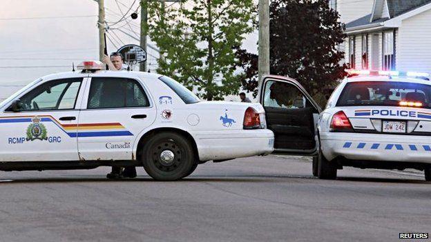 Police take cover in Moncton. 4 June 2014