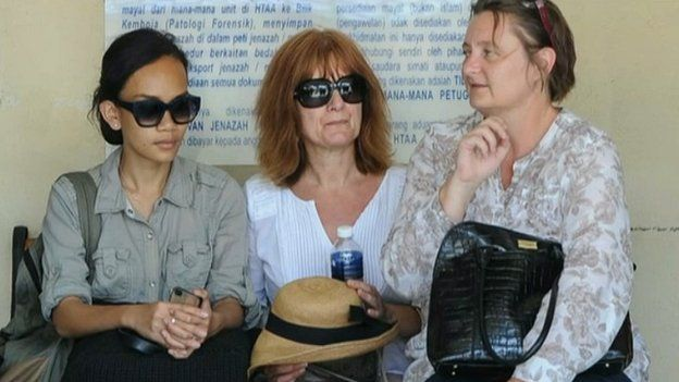 From left: Gareth Huntley's girlfriend and mother