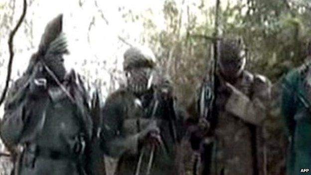 Video grab obtained by AFP on 5 March 2013 showing hooded Boko Haram fighters in undisclosed place