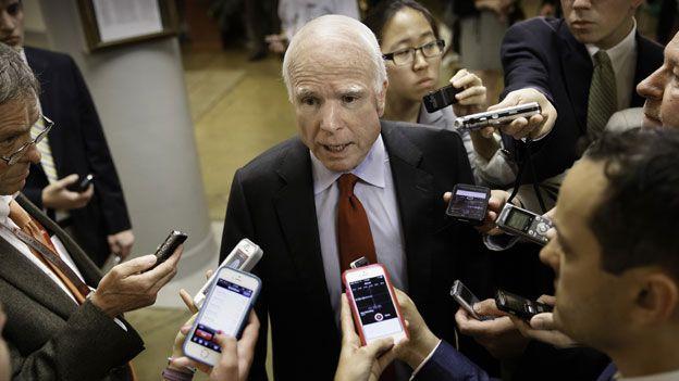 John McCain with reporters