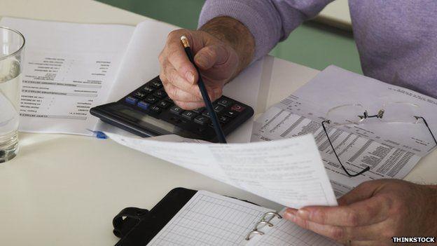 A man looks through his paperwork