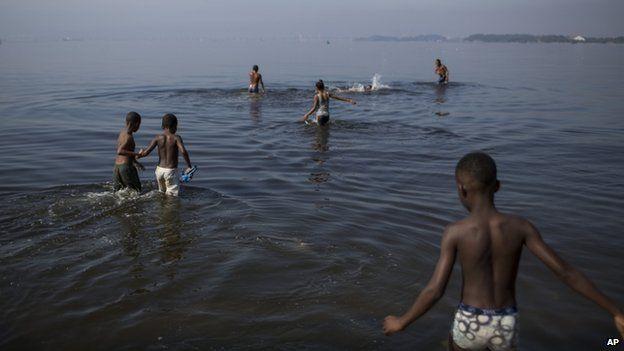 Bathers in Rio's Guanabara Bay