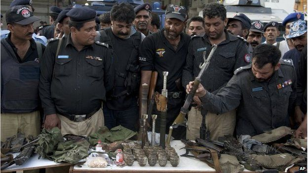 Police display weapons and ammunition brought by the militants, Jinnah International Airport, Karachi (9 June 2014)