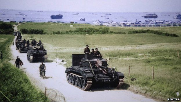 A Cromwell tank leads a British Army column from the 4th County of London Yeomanry, 7th Armoured Division, heading inland from Gold Beach on 6 June 1944