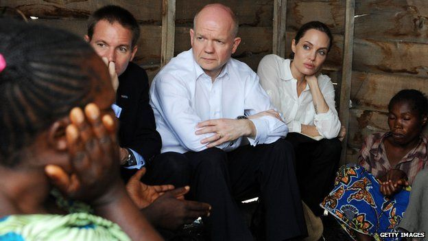 William Hague and Angelina Jolie at a rescue camp for women in the DRC (26 March 2013)