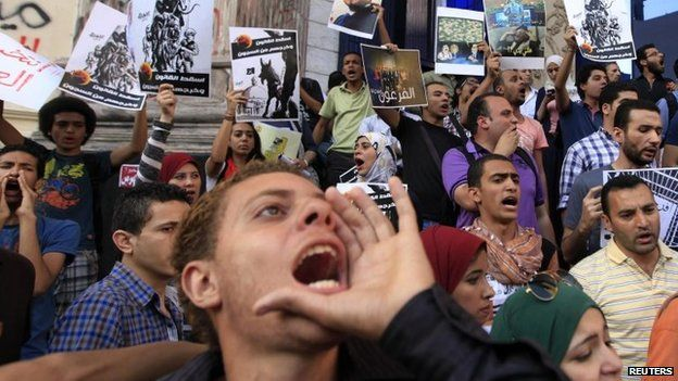 "File photo: Members of the ""April 6"" and ""Against you"" movement with liberal activists shout slogans during a protest against presidential candidate and former army chief Abdel Fattah al-Sisi and a law restricting demonstrations as well as the crackdown on activists, in downtown Cairo, 24 May 2014"