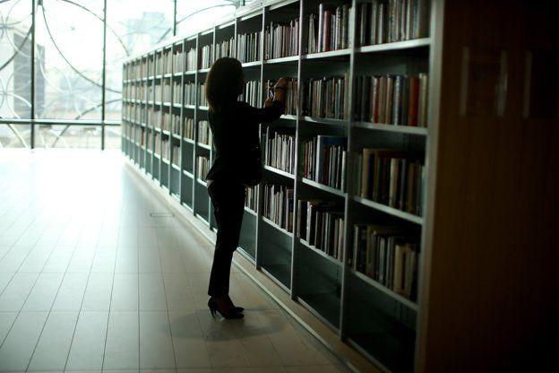 Woman browsing at library stack