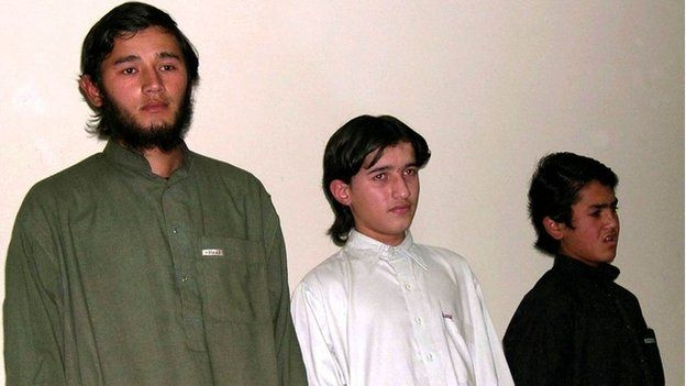 captured Central Asians alleged to be Islamic militants, from left, Abdul Qahar, 26, Mohammad Khalid, 16, and Hussain 14, are presented before media in Peshawar, Pakistan on Thursday, Nov 25, 2004.