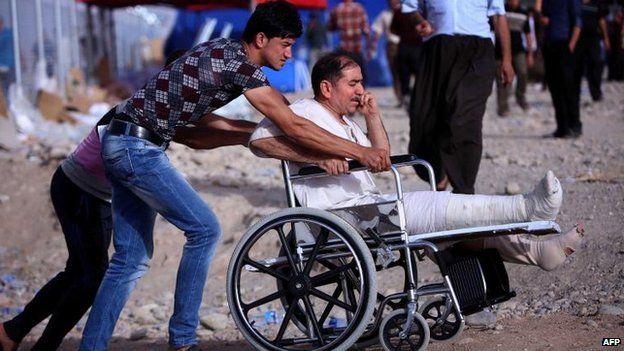 Iraqis flee to a Kurdish checkpoint at Aski Kalak, 11 June