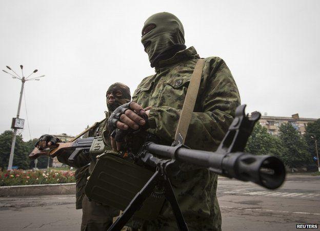 Rebel fighters in Snizhne, eastern Ukraine, 12 June