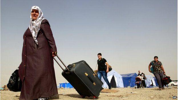 Refugees fleeing Mosul arrive in Irbil on 12 June