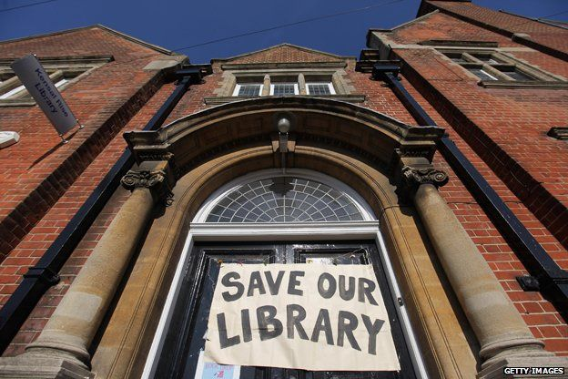 """Banner reads """"Save our library"""""""