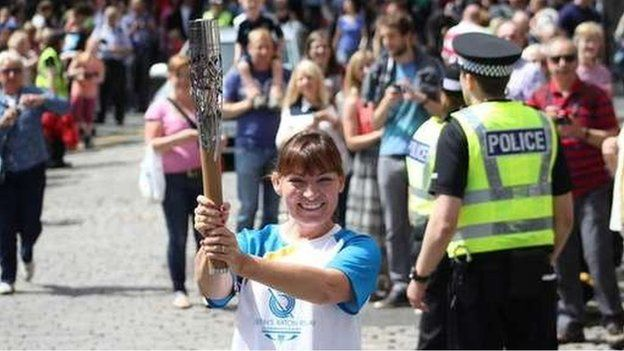 TV presenter Lorraine Kelly carried the baton on the Royal Mile
