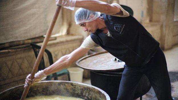 Worker in World Food Programme kitchen in West Aleppo
