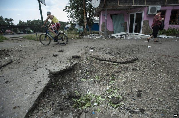 The crater left by a mortar bomb in Sloviansk, eastern Ukraine, 9 June