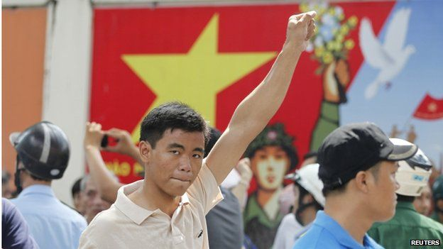 A protester gestures as he marches during an anti-China protest in Vietnam's southern Ho Chi Minh city on 18 May 2014.