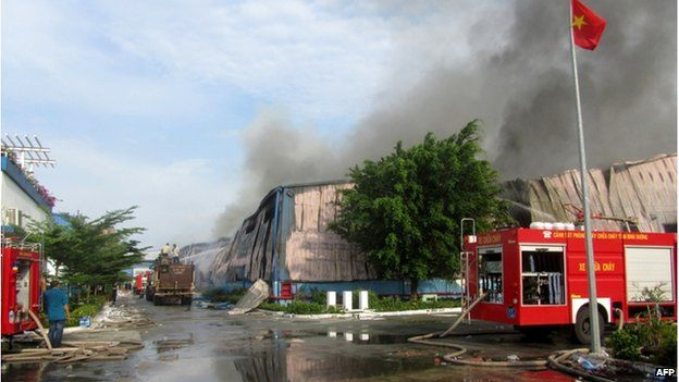 This photo taken on 14 May2014 shows smoke billowing from a Taiwanese furniture factory in Binh Duong, southern Vietnam as anti-China protesters set factories on fire.