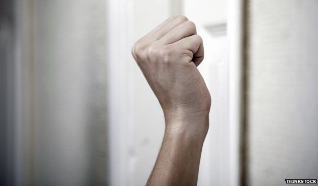 Hand raised at door