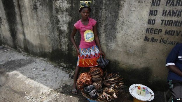 Twelve-year-old, Kemi Olajuwon, who has to drop out of school some days to sell smoked fish and make money in the Obalende area of Lagos, Nigeria, on June 17, 2014