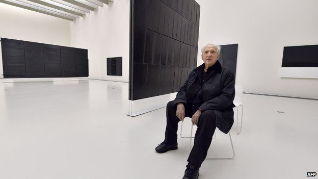 Pierre Soulages with some of his work