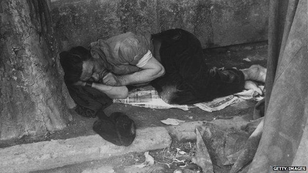 Sleeping man on street of Paris