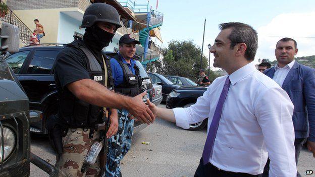 Albanian Interior Minister Saimir Tahiri meets police officers in Lazarat on 20 June 2014
