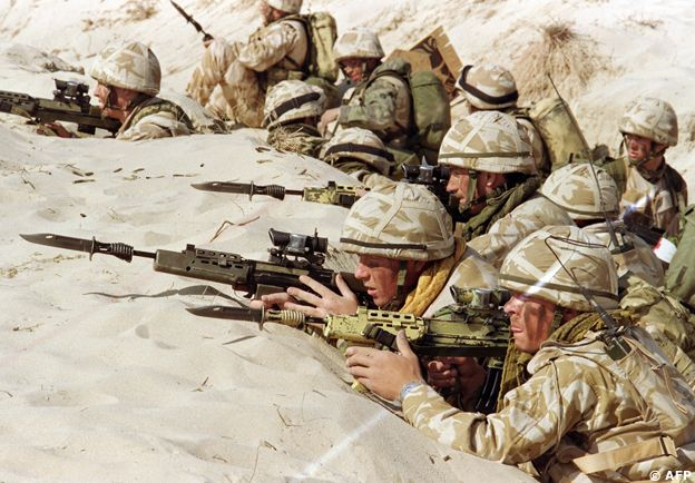 British soldiers from the First Stafford, well known as the 'Desert Rats', stand in a trench 06 January 1991 somewhere in Saudi desert, ready to attack during a live ammunition exercise, featuring the capture of an Iraqi positions