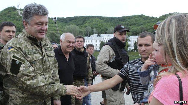 Ukraine's President Petro Poroshenko greets local residents in a town in eastern Ukraine - 20 June 2014