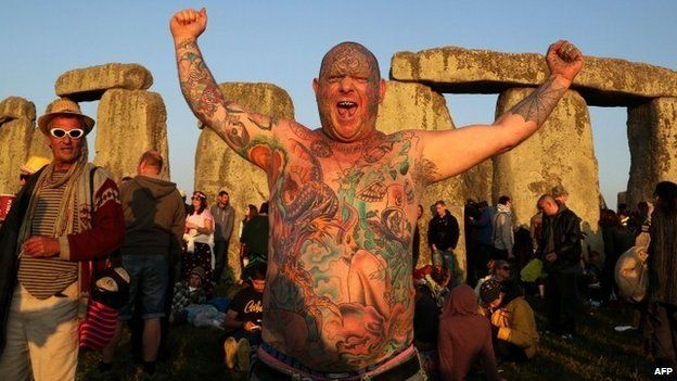 A reveller called Mad Alan (real name) celebrates the 2014 summer solstice
