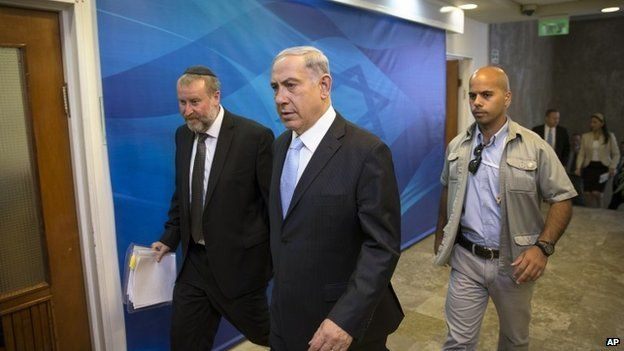 Israeli PM Benjamin Netanyahu (centre) arriving for the weekly cabinet meeting in Jerusalem, 22 June 2014