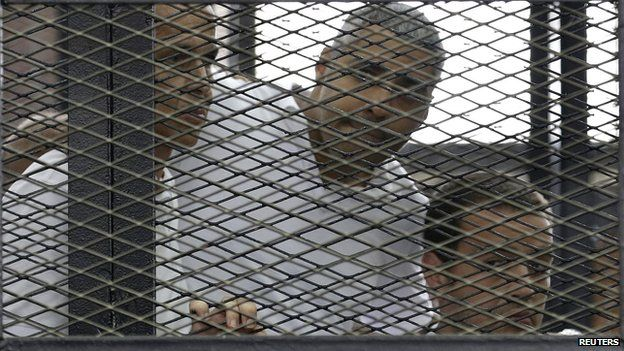 Peter Greste, Mohamed Fahmy and Baher Mohamed (L-R) listen to the ruling in court in Cairo